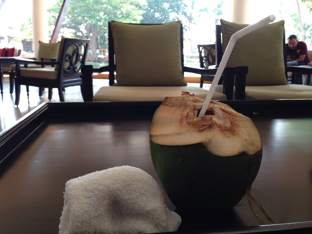 Fresh towel and coconut drink