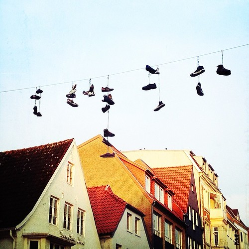 Just Hanging  #flensburg #germany #shoes by Madeleine Winnett