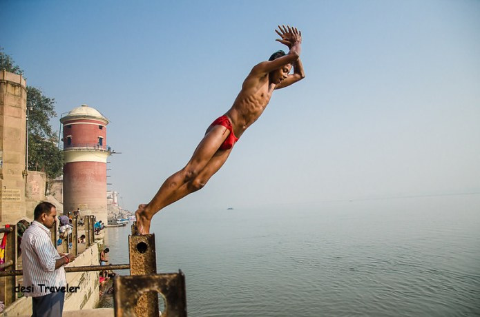 A pehlwan in langot jumps into river ganges on Assi Ghat of Varanasi