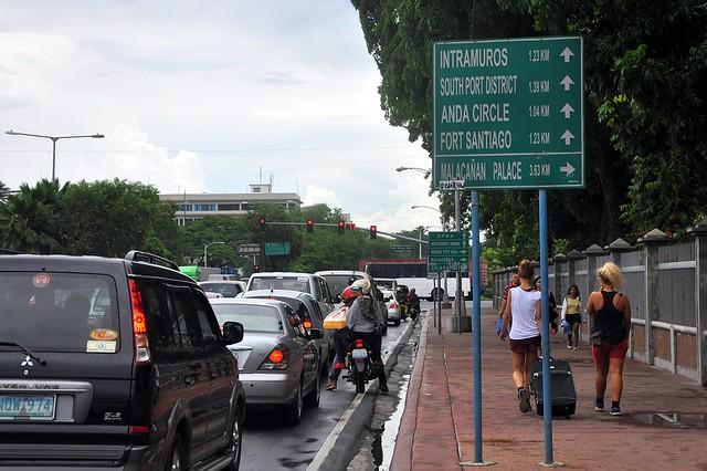 Tourists walking along Roxas Blvd