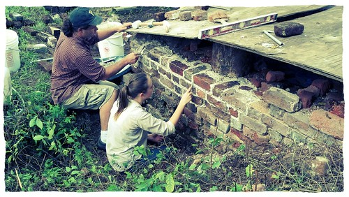 Jason Whitehead and Hallie work on repointing sections of the exterior wall of the mystery room - look at that progress!