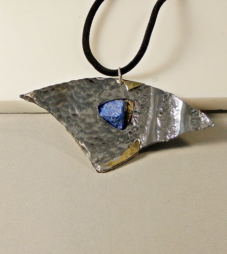 pendant stainless steel, raw Lapis lazuli, brass size 3.75x2in by Wolfgang Schweizer