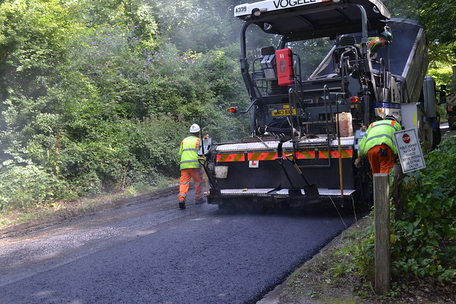 Surrey's highways contractor resurfacing a road as part of Operation Horizon