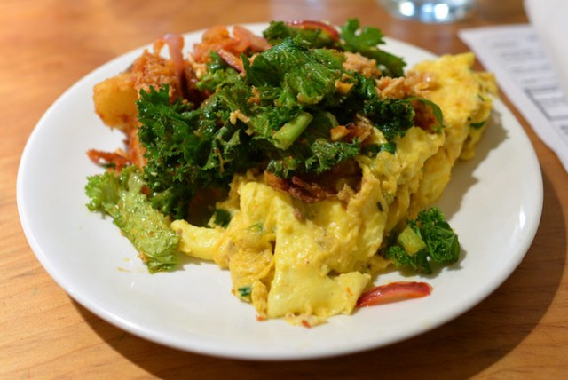 Thai Curry Pork Scramble red curry pork scramble topped with mustard greens, lemongrass ginger crunch rice, home fries