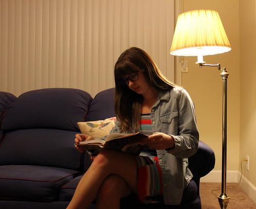 sitting, reading