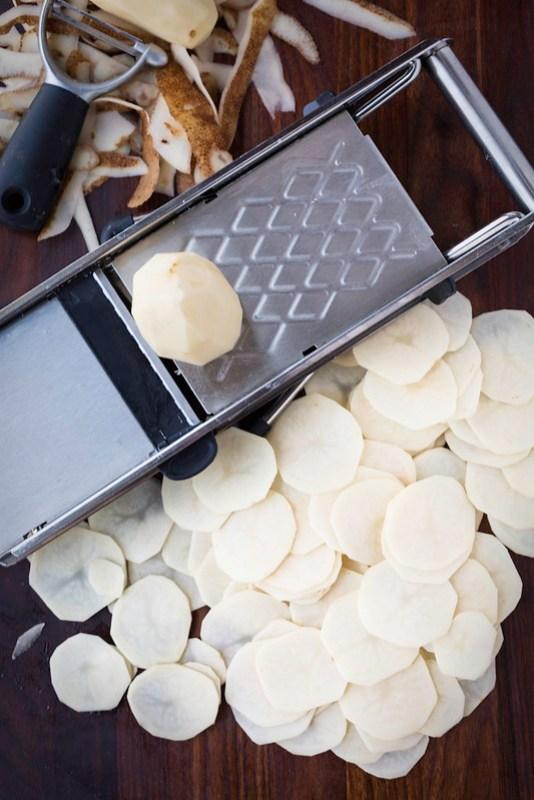 Russet potatoes sliced on mandoline