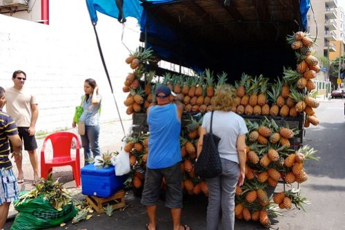 Selling pineapples on the streets of Rio de Janeiro