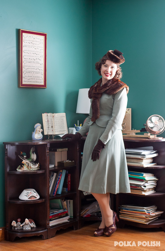 1940s sage green suit with rich brown accessories and fur trim