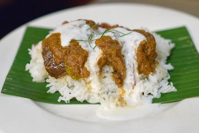 Beef Rendang short rib curry, steamed rice, sambal, kaffir lime, peanuts