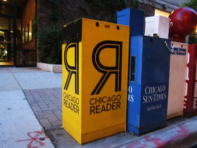 Chicago reader stand