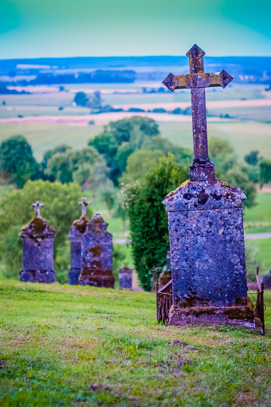 L'eglise Mont-devant-Sassey Church, France.  Fairytale setting.  Grave markers.