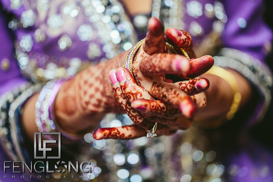 Indian bride puts on bangles on her wedding day