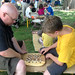 Smithsonian Folklife Festival visitors try their hand at konane (Hawaiian checkers).