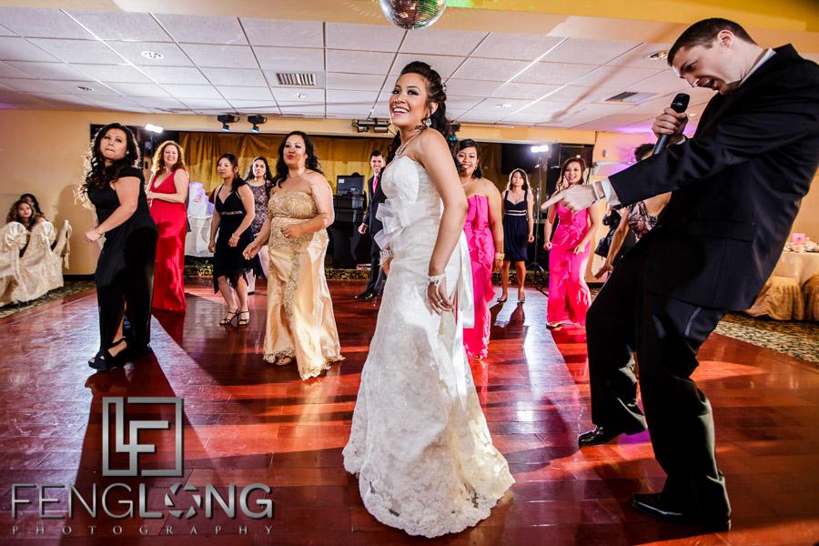 Cambodian bride and groom dance during reception in Western wedding attire