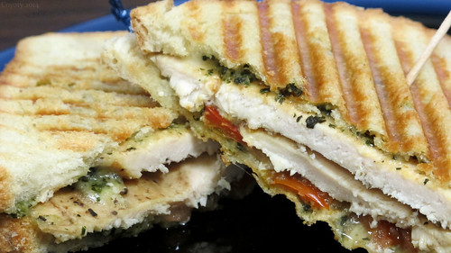 Grilled chicken, pesto, provolone, and peppers panini by Coyoty