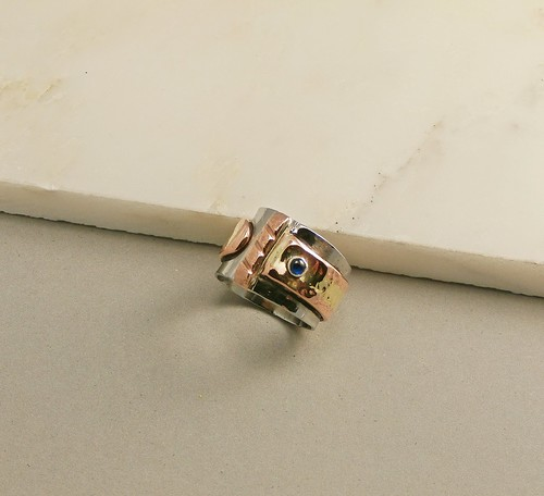 ring stainless steel, copper brass fused, Spinel synth 3mm, size 8 by Wolfgang Schweizer