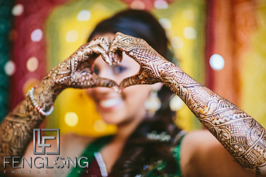 Bride on Mehndi night showing her hands with henna