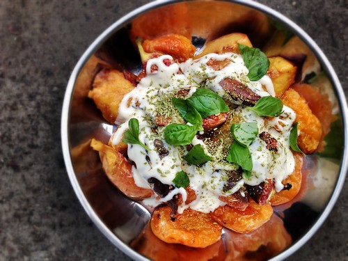 grilled apricots, peaches, and figs. with fragrant yoghurt. topped with crushed fennel seeds and fresh basil leaves