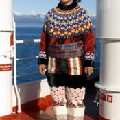 Greenlandic Inuit Woman in traditional dress on cruise ship off West Greenland.