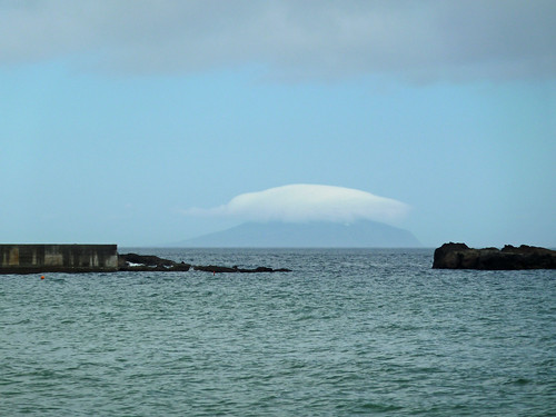 Toshima, Izu Is., covered with cloud, from Shimoda, Japan.