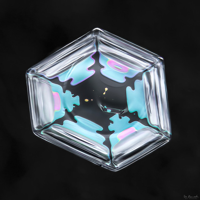 Blue ice, snowflake macro photo by Don Komarechka