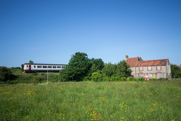 Train and Derelict House