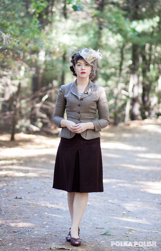 1940s ensemble in brown, cream, and blue-grey slate featuring a feathered tilt hat, a mismatched suit, and faux reptile slingback shoes