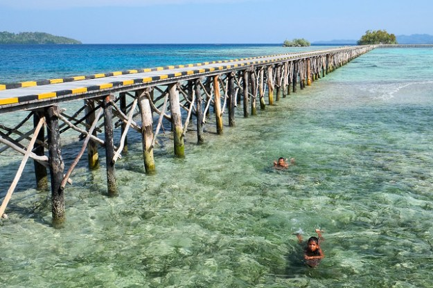 Bridge swimmers. Malenge, Togean Islands, Indonesia