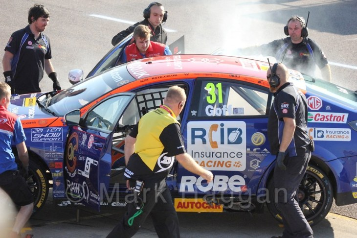 Jack Goff's smoky car in BTCC at Rockingham 2015