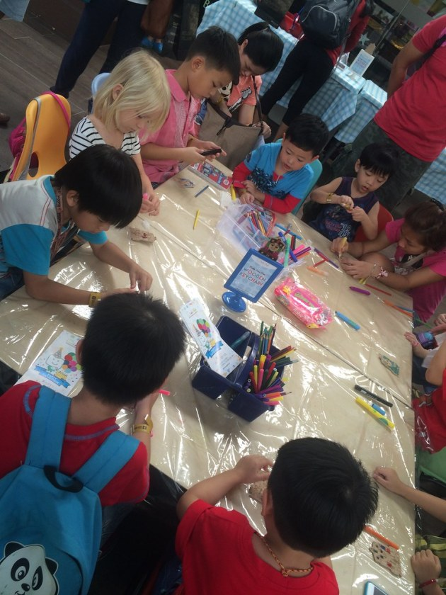 Busy focusing on decorating key chains and colouring at Thomas & Friends Family Day.