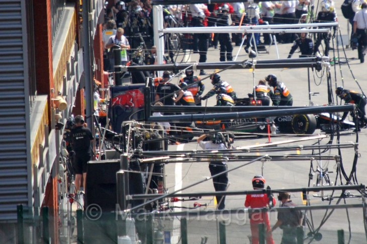 Nico Hulkenberg's Force India returns to the pits after stalling on the grid at the 2015 Belgium Grand Prix