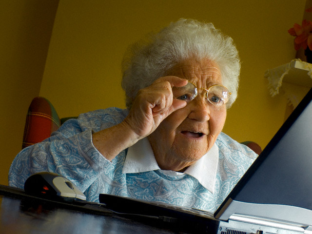 Elderly Woman Looking at Laptop Computer Screen