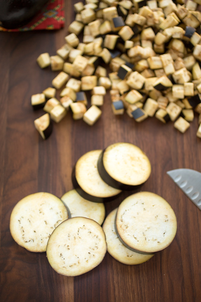 sliced and cubed eggplant on cutting board
