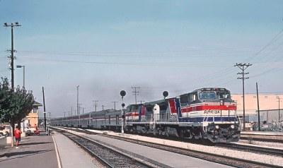 Amtrak P32-8BWH 506 and a sister Pepsi Can handle Train 11, the Coast Starlight, at Santa Clara, CA  on October 2, 1994