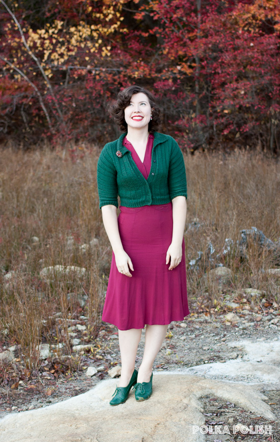 Vintage raspberry pink rayon dress paired with green sweater and shoes