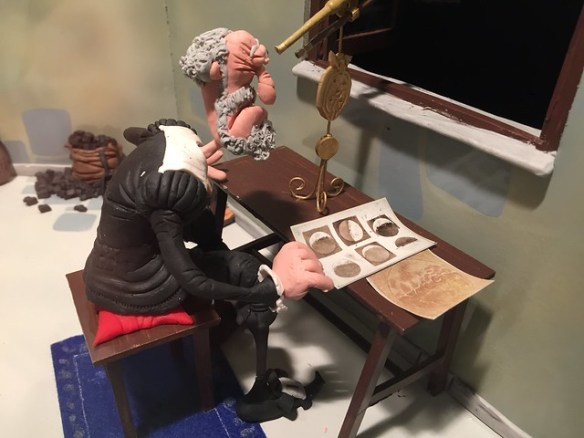 """Galileo con una página de """"Mensajero de las estrellas"""""""