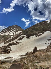 Mike crossing a snow field below Windom Peak