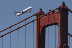 A United Airlines Boeing 777-300ER flies over the Golden Gate Bridge during Fleet Week 2019 in San Francisco, California on October 11, 2019 (Photo by Yichuan Cao/Sipa USA)