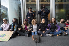 Young climate activists and protesters gather in front of investment firm BlackRock's office and block the entrance in San Francisco, California, on December 6, 2019, advocating the company to divest fossil fuel. (Photo by Yichuan Cao/Sipa USA)
