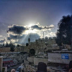 Nearby Lion's Gate, from the muslim cemetery, rays of light over a Muslim minaret in the Old City