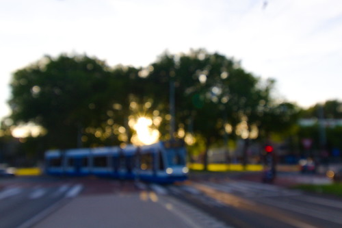 """Bokeh of sunset behind tram - Amsterdam, Netherlands • <a style=""""font-size:0.8em;"""" href=""""http://www.flickr.com/photos/104409572@N02/50207610966/"""" target=""""_blank"""">View on Flickr</a>"""