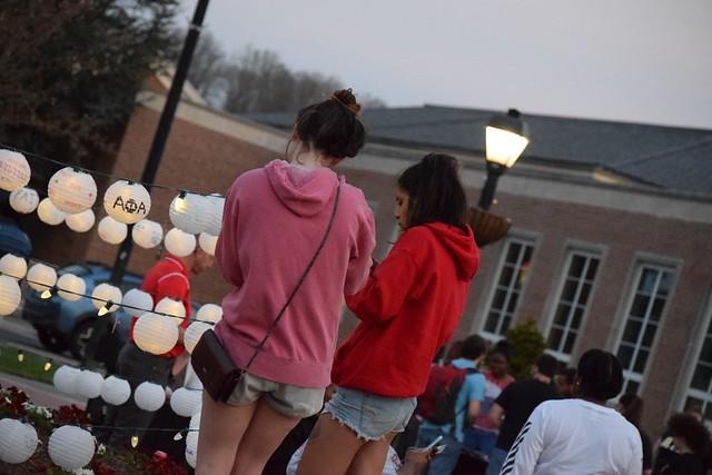Students hanging their lanterns