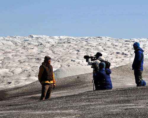 Corina Gamma interviewing Thomas Overly in front of the ice sheet.