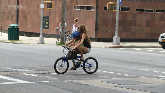 mother and child on bike. somehow this doesn't seem safe?
