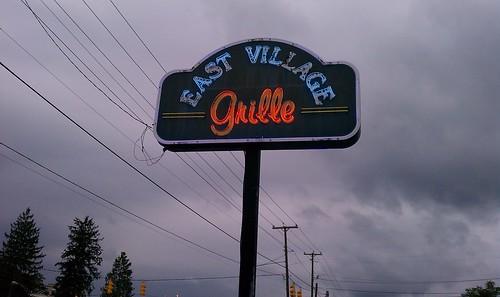 East Village Grille sign, at dusk