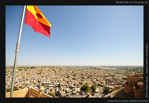 Flag flies high over the golden city