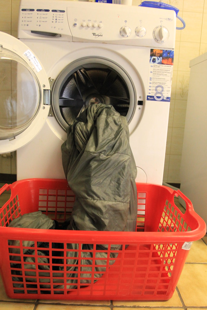 Carefully remove the down bag from the washer