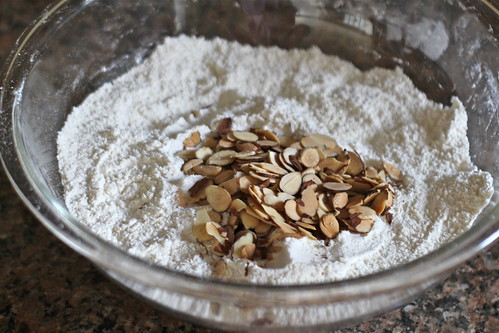 adding sliced almonds to dry ingredients