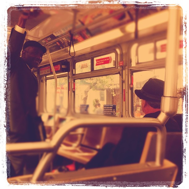 Two men complimenting each others' hats. #muni