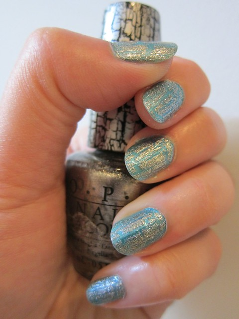 OPI in Silver Shatter over Essie in Beach Bum Blu